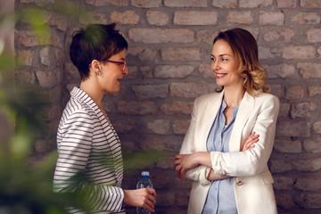 Females talking in office