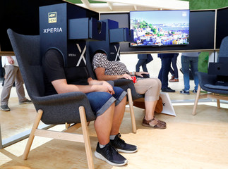 Visitors watch a Xperia 4K HDR presentation from Sony at the IFA Electronics Show in Berlin