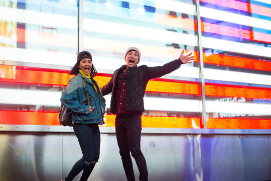 Lovely couple jumping in Times Square