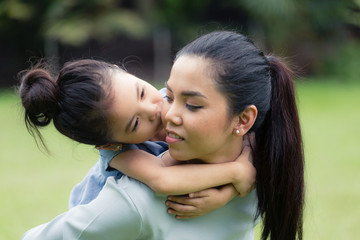 Child Hugging Mom from Behind