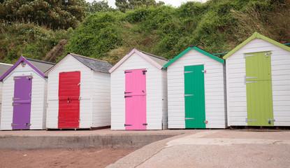 Colourful beach huts on a beach in Torquay