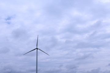 Dark Cloudy Day with Windmill on the Horizon
