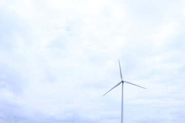 Modern Wind Mill with Heavy Clouds in the Distance