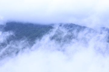 The Fog and Clouds Meet in the Middle of the Smoking Mountains