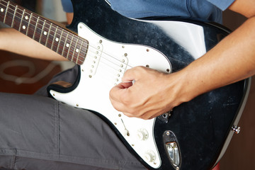 Close up of a lefty electric guitar being played