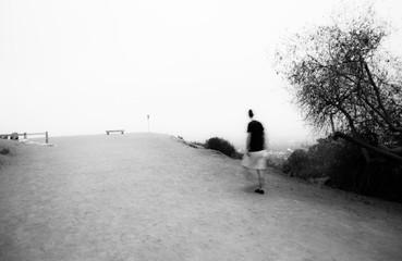 ghost man walking on a hill