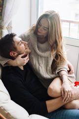 Pretty young sensual happy couple winter portrait