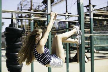 young woman on the sports ground