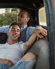 Gay couple cutting in truck