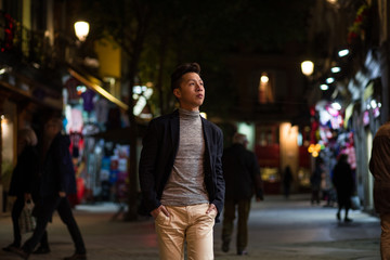 Casual young chinese man in madrid at night