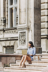 Young Businesswoman Working on Her Laptop Outdoors