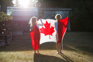 Two girls and a Canadian Flag.