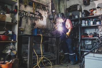Welder With Helmet Working