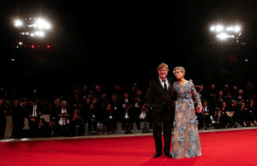 Actors Fonda and Redford pose during a red carpet to receive a Golden Lion award for lifetime achievement at the 74th Venice Film Festival in Venice