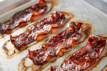 Row of roasted bacon slices