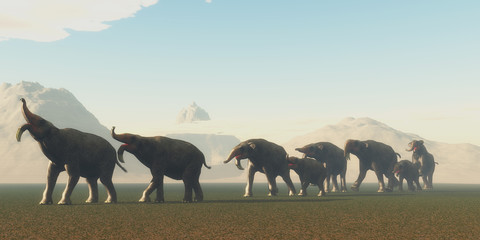 Deinotherium Herd - A herd of Deinotherium mammals head to a watering hole in the Pleistocene Period of Africa.
