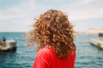 Back portrait of a curly woman