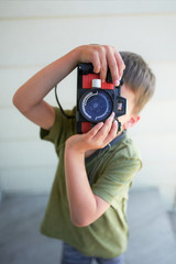 boy takes photos with camera
