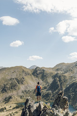 Man Hiker Standing on Mountain Cliff
