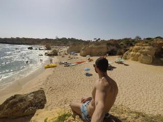 Guy taking a selfie in a beach in Algarve, Portugal