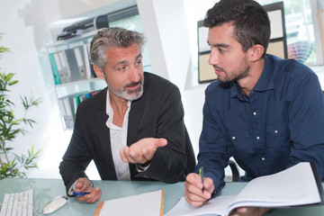businessmen in office working out new plan for future project