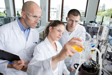 young scientists wearing protective glasses in clinical laboratory
