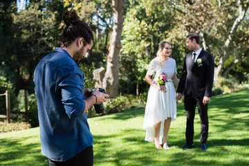 Photographer reviewing photographs on digital camera