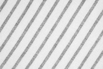 Black and white striped pattern linen fabric texture background, detail closeup
