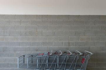 row of empty shopping carts in the big supermarket