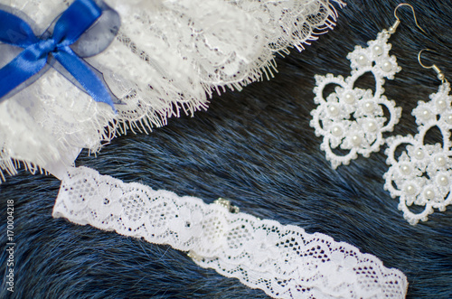 White Lace Bridal Accessories On The Fur Blue Background Wedding