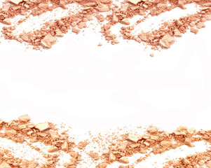 Face powder, crushed powder on white background.