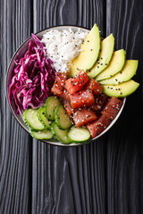 Raw Organic Ahi Tuna Poke Bowl with Rice and Veggies close-up. Vertical top view