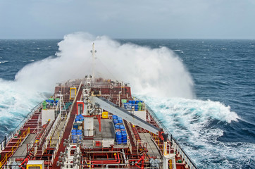 An oil tanker vessel against rage of the ocean