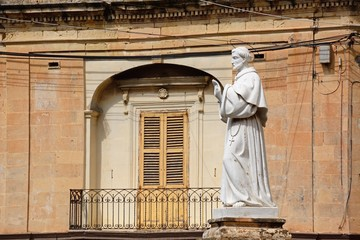 Monk statue outside the Parish church of our lady of sorrows, Bugibba, Malta.
