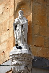 Statue of St Paul in an alcove on the corner of a building, Bugibba, Malta.