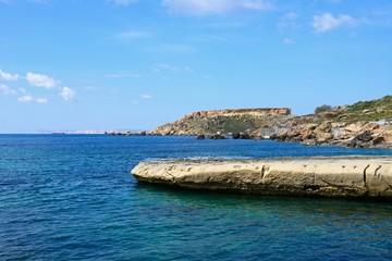 View of Ghaja Tehheiha Bay with the rocky coastline in the foreground, Ghajn Tuhheiha Bay, Malta.