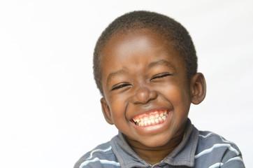 Awesome huge smile on black African ethnicity black boy child isolated on white Portrait Fotoväggar