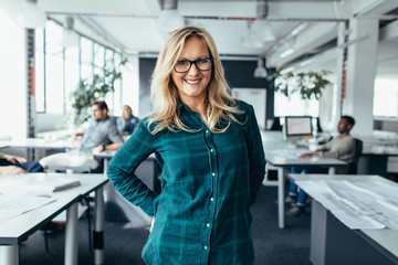 Attractive businesswoman in casuals at modern office