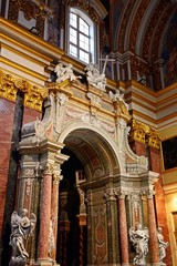 Elaborate archway surrounded by statues of angels inside St Pauls Cathedral also known as Mdina Cathedral, Mdina, Malta.