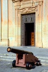 Cannon outside the entrance to St Pauls Cathedral also known as Mdina Cathedral, Mdina, Malta.