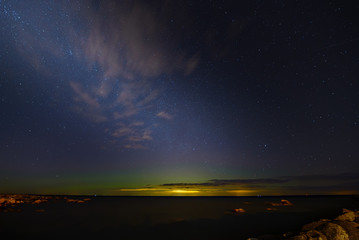 Aurora Boralis and milky way on a Bltic sea