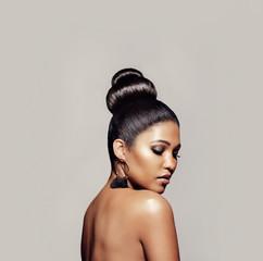 Elegant young woman with hair bun