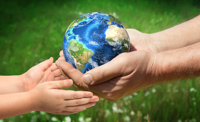 The man gives planet Earth to baby. Ecology concept. Elements of this image furnished by NASA Wall mural