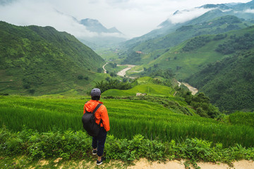 Young traveler standing and looking at view of nature at Sapa, vietnam