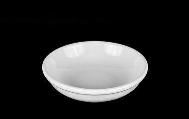 White dish on black