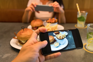 Taking photo on cellphone in restaurant