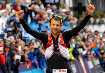 Francois D'Haene of France celebrates winning the 15th Ultra-Trail du Mont-Blanc (UTMB) race in Chamonix