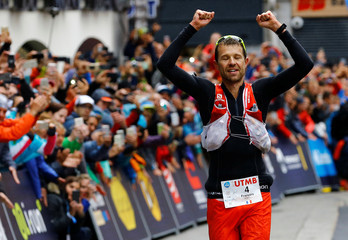 Francois D'Haene of France celebrates winning the 15th Ultra-Trail du Mont-Blanc (UTMB) race in Chamonix