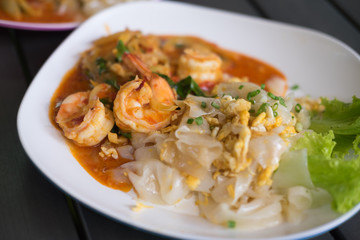 Stir fried noodles with Tom Yum Kung