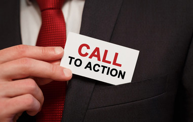 Businessman putting a card with text Call To Action in the pocket